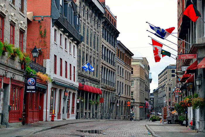 Montreal's colorful buildings and vibrant communities attract thousands of new residents annually
