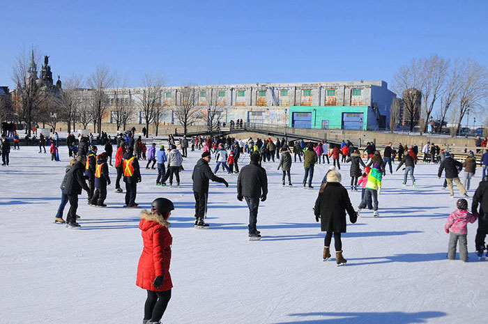 Moving Attractions of Montreal - Ice skating in the snow in the Old Port