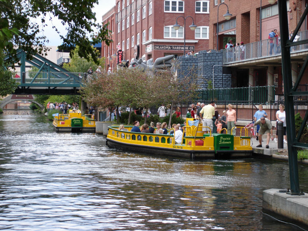 Canal in Bricktown – enjoy pleasant weather riding water taxis in this scenic waterway  Source: Wikipedia