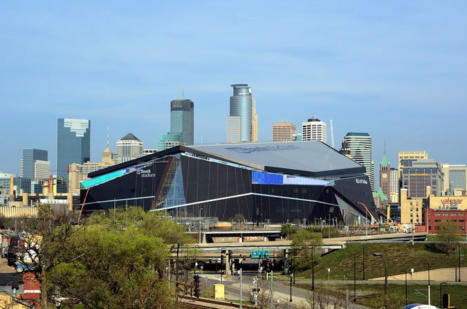 Live and work in Downtown Minneapolis – US Bank Stadium with downtown skyline