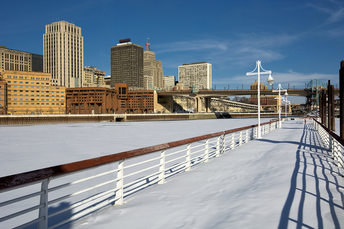 St Paul winter – snow and ice covered Mississippi River with downtown view