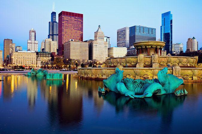 The City of Chicago's beautiful skyline reflected in Buckingham Fountain