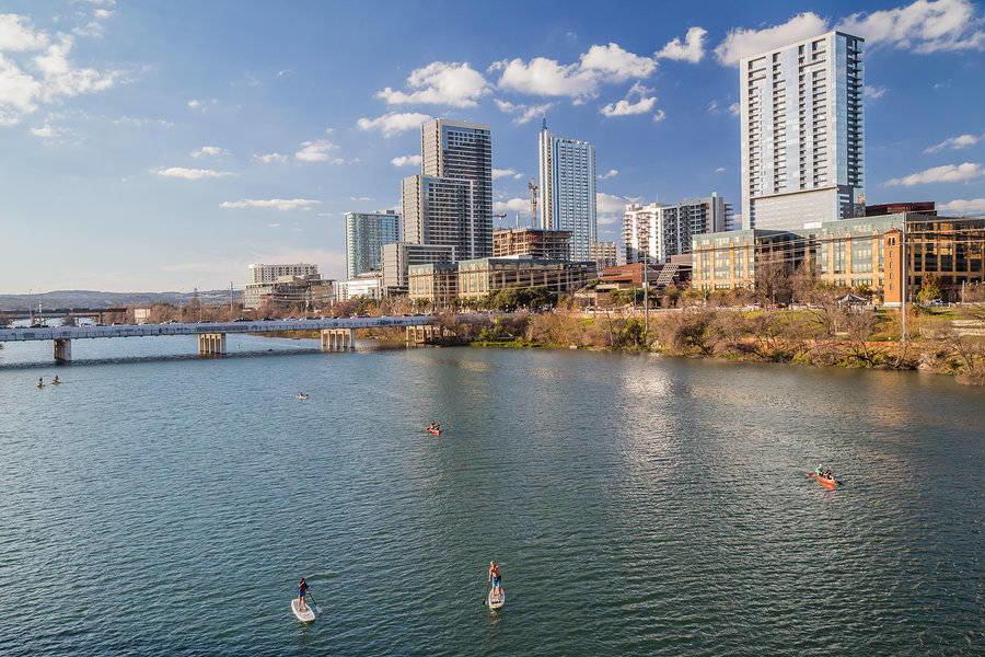 View of Downtown Austin with kayaking activities in the Colorado River