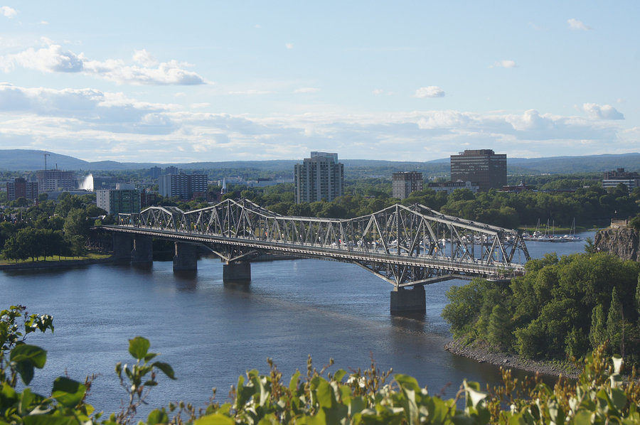 The Royal Alexandra Bridge spans the Ottawa River between Gatineau and Ottawa