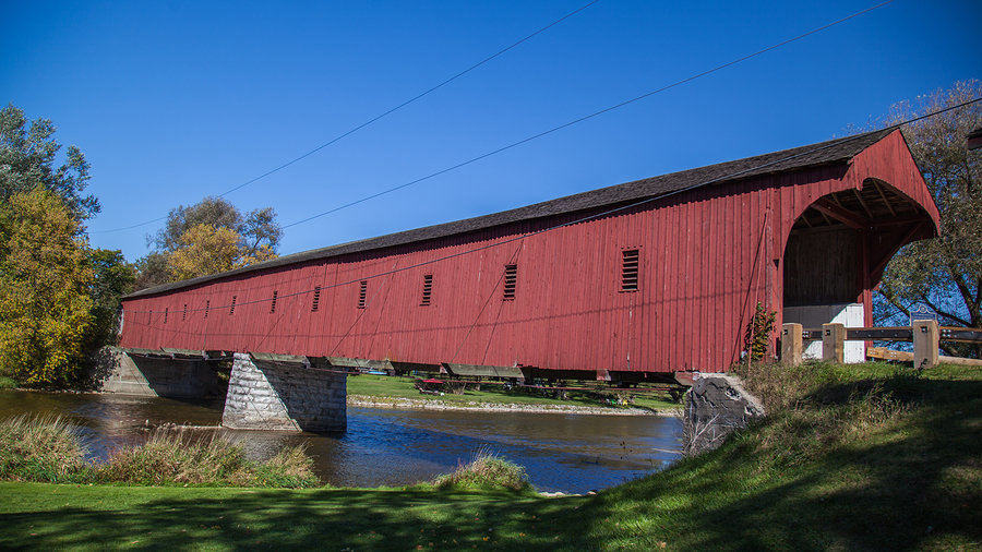 West Montrose (Kissing Bridge) covered bridge in autumn in Waterloo, Ontario